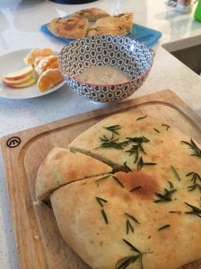 Pizza bread flavoured with garlic and thyme, and porridge for breakfast and school lunches