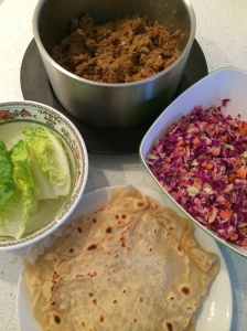 Pulled pork, lettuce, coleslaw and tortillas